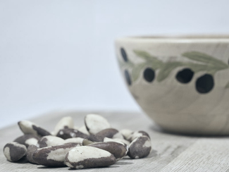 Brazil nuts in front of a bowl