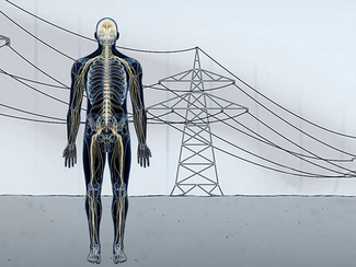 Man in front of power transmission line