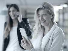 two young women using mobile phone and smart phone
